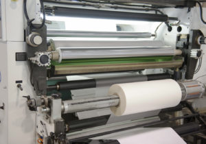 Paper laminate machine with cylinders front and back.
